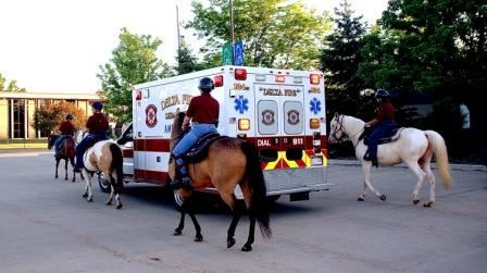 Mounted Division Riding Horses by Ambulance