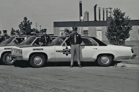 1976 - Left to right, Deputy Benden, CPL Eaton, Deputy Fabiano